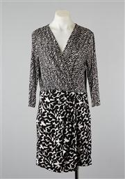 Sale 8740F - Lot 77 - A Diane Von Furstenberg abstract print black and white dress, size 12.