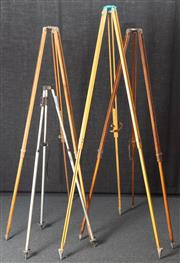 Sale 8984W - Lot 511 - A collection of three timber surveyors stand and a metal example. Height of tallest 203cm