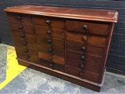 Sale 9014 - Lot 1025 - Good 19th Century Cedar Triple Bank Chest of 18 Drawers, with timber knobs, rounded corners & plinth base (h:105 x w:156 x d:51cm)