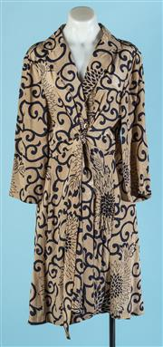 Sale 9090F - Lot 123 - A TRELISE COOPERLONG SLEEVE DRESS; in coffee and navy silk with inticate beaded swirl designs embellished all over, size 16