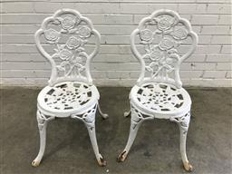 Sale 9102 - Lot 1299 - White painted pair of cast iron outdoor chairs (h:85 x w:37cm)