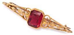 Sale 9124 - Lot 445 - AN ANTIQUE 9CT GOLD STONE SET BROOCH; pierced conical shaped brooch set with an emerald cut red paste, length 55mm, wt. 4.48g.