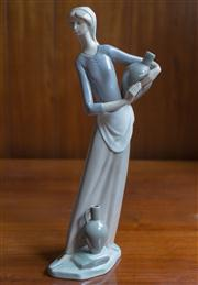 Sale 8313A - Lot 95 - A Lladro figure of a water carrier, Daisa, incised marks, height 34cm