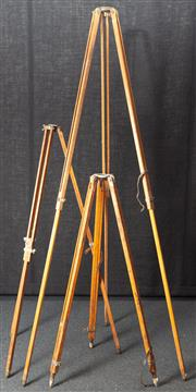 Sale 8984W - Lot 512 - Three timber surveyors stands of various sizes, the tallest 215cm