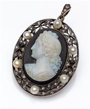 Sale 9015J - Lot 76 - An antique hardstone cameo pendant brooch, C: 1880's, the beautifully detailed portrait hardstone cameo set within a gold and silver..