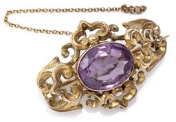 Sale 9124 - Lot 358 - AN ANTIQUE AMETHYST BROOCH; centring an oval cut amethyst of approx. 6ct in a scrolling frame, tests 8ct gold, size 35 x 25.5mm, bro...