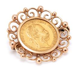 Sale 9182 - Lot 363 - A 1915 AUSTRIAN 1 DUCAT GOLD COIN BROOCH; set in 14ct gold scroll and bead work frame with a restike 1 ducat coin in 0.986 gold (23....