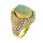 Sale 8253 - Lot 379 - AN 18CT GOLD OPAL AND GEMSET DRESS RING; featuring an oval cabochon Ethiopian opal in claw set mount studded with round brilliant cu...