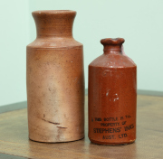 Sale 8795A - Lot 69 - Two earthenware bottles, the smaller glazed example of larger marked Stephens Inks, height 16cm
