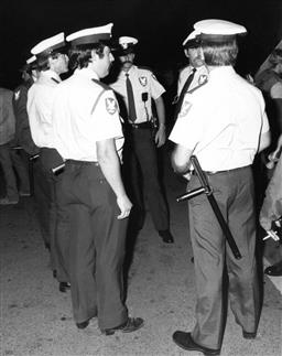 Sale 9082A - Lot 5049 - Security guards, Sydney Gay and Lesbian Mardi Gras Parade (1985), 20 x 25 cm, silver gelatin, Photographer: Tony Lewis