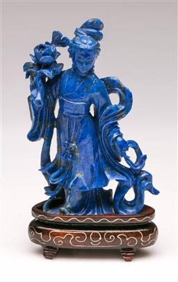 Sale 9119 - Lot 54 - A Chinese Lapis Lazuli carving of Guanyin, on rosewood stand (H:10cm) (Chipped)