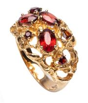 Sale 9015J - Lot 74 - A vintage 9ct gold ring C: 1970's, claw set with 3 oval and 4 round cut garnets