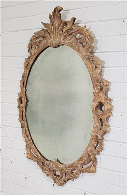 Sale 9196 - Lot 1050 - Rococo Style Carved Oval Mirror, with white washed finish, having a pierced frame surmounted by a scroll (112 x 70cm)