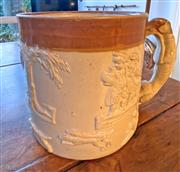 Sale 9031H - Lot 62 - c1900 Royal Doulton Large Mug, Brown and Cream with embossed people and animals, no. 2892 H 12cm x D 12cm, Total width is 17cm -
