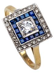 Sale 9015J - Lot 73 - A vintage 18ct gold diamond and sapphire ring, set to the centre with a diamond framed by 16 square cut sapphires with an outer fram...