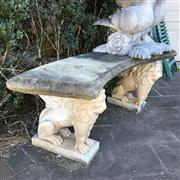 Sale 8795K - Lot 71 - A curved stone bench with lion form bases