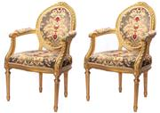 Sale 8940J - Lot 25 - Pair of French Louis XVI giltwood armchairs in floral upholstery, the medallion backs surmounted by carved ribbons and rosettes with...