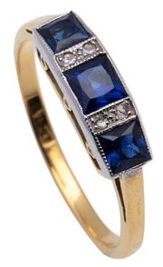 Sale 9015J - Lot 72 - An art deco 18ct gold sapphire and diamond ring, the 3 square cut blue sapphires spaced by 4 diamonds