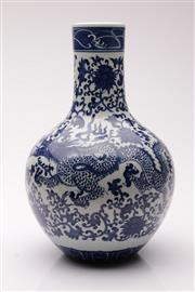 Sale 9040 - Lot 25 - A Blue and White Dragon Themed Chinese Vase (H 31cm)
