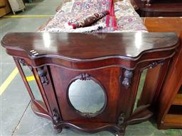 Sale 9102 - Lot 1003 - Victorian Possibly Mahogany Credenza, with serpentine shaped top, above an oval and rectangular side panel doors (95 W:136 D:39cm)