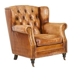 Sale 9123J - Lot 105 - Caramel top grain leather armchair featuring a wide, deep buttoned back, brass stud detailing and front castor wheels. (W 83cm x D 8...