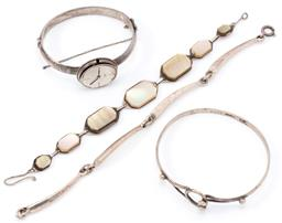Sale 9145 - Lot 320 - FOUR VINTAGE SILVER BRACELETS AND BANGLES; Italian 4 curved bar link to bolt ring clasp, length 18.5cm, 7 graduated plaques set with...