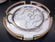 Sale 8310A - Lot 87 - A pair of non-matching serving trays, one with rope form handles (diameter 48cm) the other on triform base with glass.