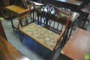 Sale 8390 - Lot 1049 - Late Victorian Inlaid and Carved Mahogany Settee pierced back with padded section and seat and on tapering legs.