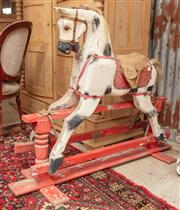 Sale 9060H - Lot 38 - An antique timber rocking horse with painted finish and leather saddle. Length  120cm