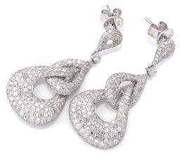 Sale 9124 - Lot 485 - A PAIR OF WHITE GOLD DIAMOND DROP EARRINGS; articulated 9ct white gold drops pave set with single cut diamonds totalling 4.03ct, len...