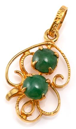 Sale 9128J - Lot 22 - AN 18CT GOLD JADE PENDANT; scrolling frame set with 2 round cabochon jadeite jades, length 21mm, wt. 0.93g.