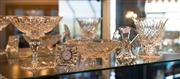 Sale 7984 - Lot 45 - A shelf lot of crystal wares to include a Waterford clock, baccarat peacock, Stuart bonbonieres.