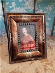 Sale 8500A - Lot 57 - A decorative timber photo frame - Condition: As New - Measurements: 27cm high x 21cm wide