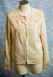 Sale 8577 - Lot 159 - A vintage cream woollen cardigan with beading detail/ lined, size 12, Condition: Very Good (minor spots on one cuff)