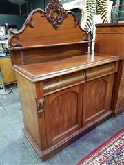 Sale 8653 - Lot 1001 - Late 19th Century Cedar Chiffonier, the carved back with shelf, above two frieze drawers & two shaped panel doors