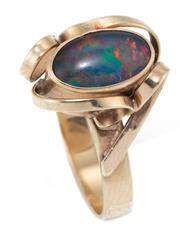 Sale 8915 - Lot 326 - A 9CT GOLD OPAL RING; rub set with an opal triplet with applied flat wire ribbons, size O1/2, wt. 3.21g.