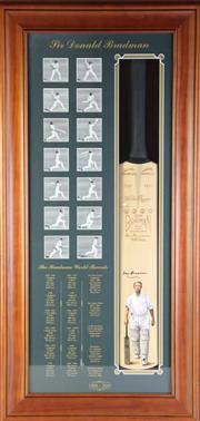 Sale 8989 - Lot 24 - Sir Donald Bradman Signed Commemorative Cricket Bat with Certificate of Authenticity (2) (114cm x 55cm)