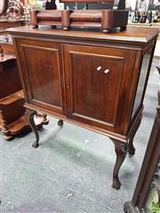 Sale 8559 - Lot 1020 - Mahogany Raised Cabinet, with two panel doors enclosing shelving & on carved cabriole legs.