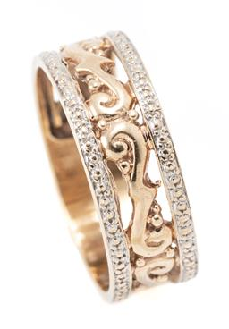 Sale 9182 - Lot 362 - A 9CT GOLD RING; 7.5mm wide pierced scrolling design, size T, wt. 3.85g.