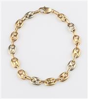 Sale 8369A - Lot 310 - A three tone 18ct gold Gucci link bracelet, 10.6g
