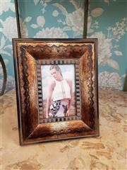 Sale 8500A - Lot 58 - A decorative timber photo frame - Condition: As New - Measurements: 27cm high x 21cm wide