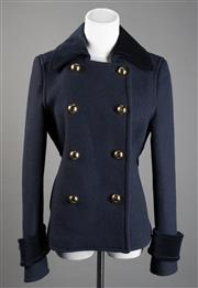 Sale 8499A - Lot 98 - A Coach (USA) black wool double breasted jacket with velvet collar and cuffs and goldtone buttons. Size: 6. Unworn.