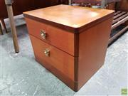 Sale 8607 - Lot 1085 - Pair of Stag Teak Bedside Chests