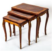 Sale 9015J - Lot 28 - A nest of 3 vintage interlocking occasional tables C: 1950, each inlaid with a burr walnut tablet bound by boxwood stringingand a wi...
