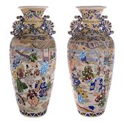 Sale 8000 - Lot 187 - A pair of Kyoto ware baluster vases with raised polychrome decoration depicting a court scene.