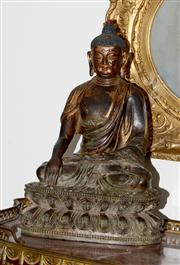 Sale 8088A - Lot 39 - An early gilt bronze Buddha; one hand touching the earth, h 31.5cm