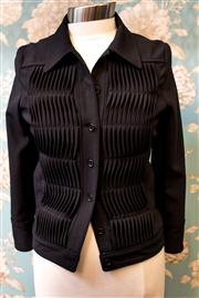 Sale 8577 - Lot 161 - A 100% wool Cacharel jacket with front and back pleated detail, size 38, Condition: Excellent