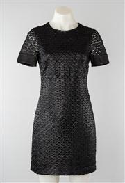 Sale 8740F - Lot 147 - A Diane von Furstenberg black shift dress with metallic lace overlay and satin trim to sleeves, US size 0