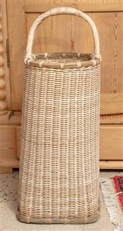 Sale 9060H - Lot 43 - A tightly woven elongated basket with handles. Height 80cm