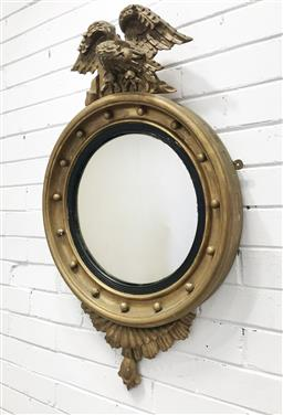 Sale 9097 - Lot 1042 - Regency Style (20th Century) Carved Gilt Timber Convex Mirror, the frame with balls and ebonised slip, surmounted by an eagle, with...
